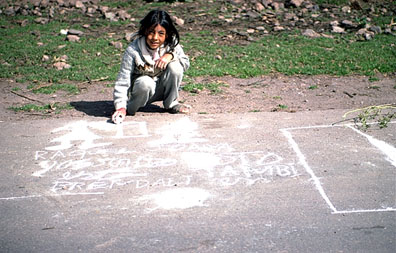 Girl Drawing With Chunks of Cement