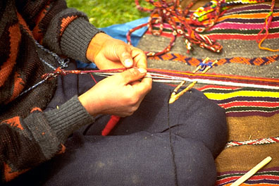 "Boy Weaving The ""Eye"" Pattern"
